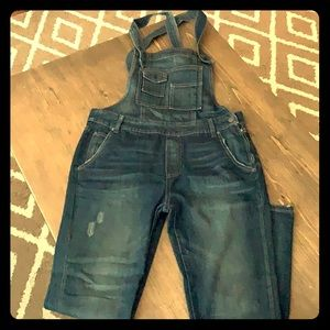Free People blue jean overalls.